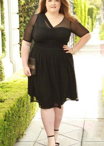 Zwarte jurk voor de volledige combo-stoffen van verschillende texturen