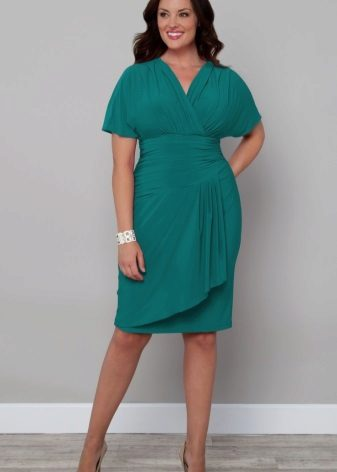Medium length dress with draping belly-covering