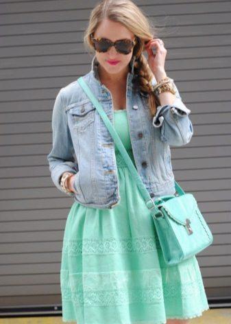 Denim jacket under a mint dress