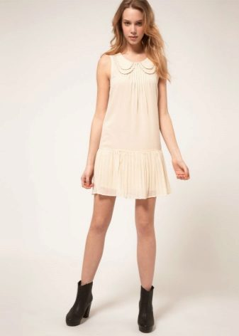Dress with a pleated skirt for an inverted triangle type figure