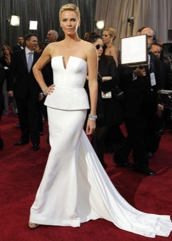 Long white bustier dress with a basky and train