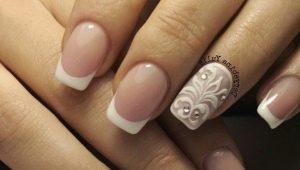 Witte french met een patroon op de nagels: originele ideeën en relevantie