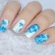 Heldere en ongebruikelijke manicure met korenbloemen