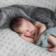 Newborn baby and cat in the apartment