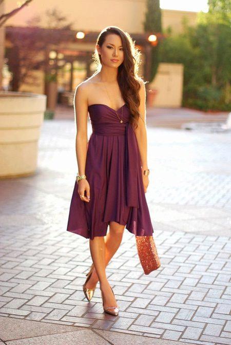 Oranžová taška na fialové šaty