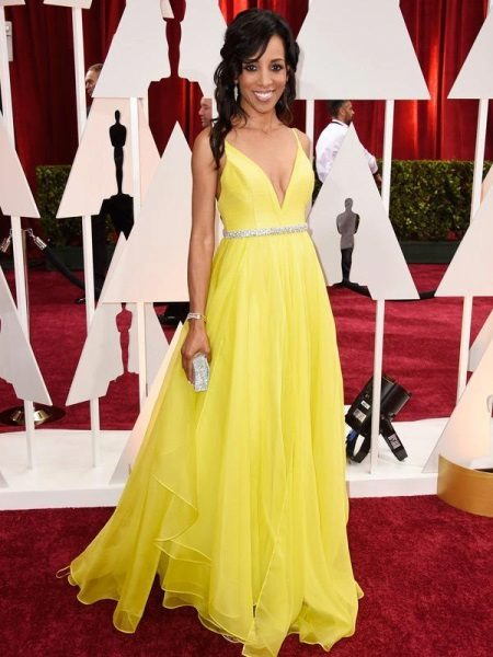 Yellow evening dress with clutch