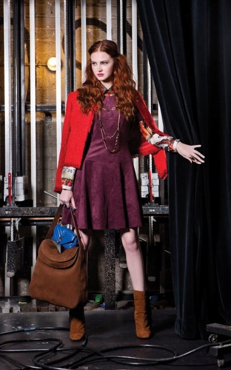 Eggplant color dress in combination with a red jacket