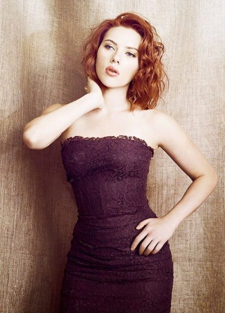 Redhead in dress of eggplant color