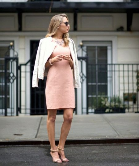 Sheath dress in combination with a jacket