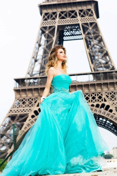 Beautiful turquoise dress with a train with open shoulders