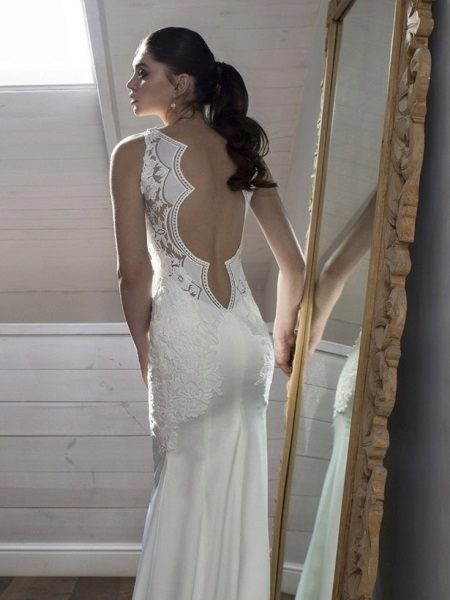 Dress with figured cut on a back